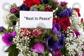 """Bouquet of flowers with """"Rest In Peace"""" card"""