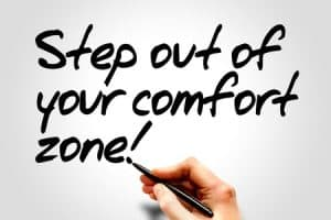 Step out of your comfort zone sign