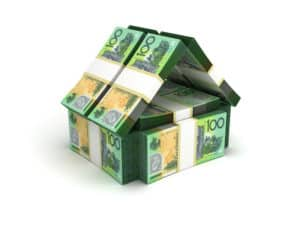 House shape made out of wads of $100 dollar bills