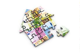 jigsaw puzzle in the shape of a house picturing bank money notes