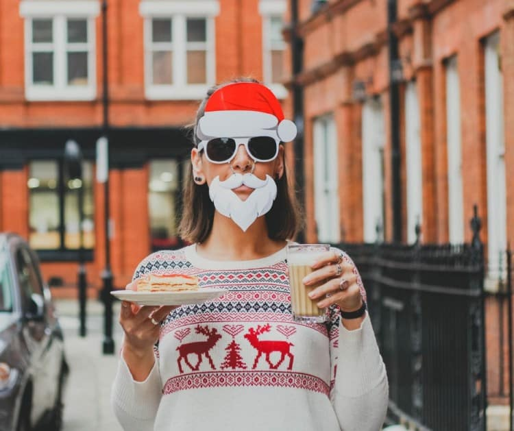 mortgage brokersydney -lady with facial and head christmas attire holding a sandwich plate and a milky drink glass